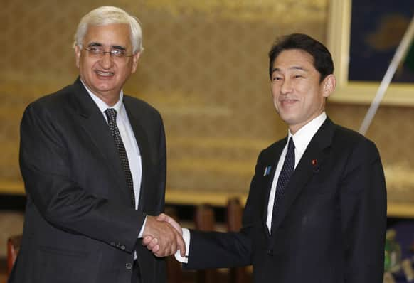 Foreign Minister Salman Khurshid and his Japanese counterpart Fumio Kishida pose for photographers prior to their meeting at Foreign Ministry`s Iikura guesthouse in Tokyo.