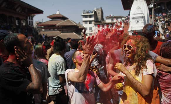 Foreign tourists dance as they celebrate Holi, the Hindu festival of colors, in Katmandu.