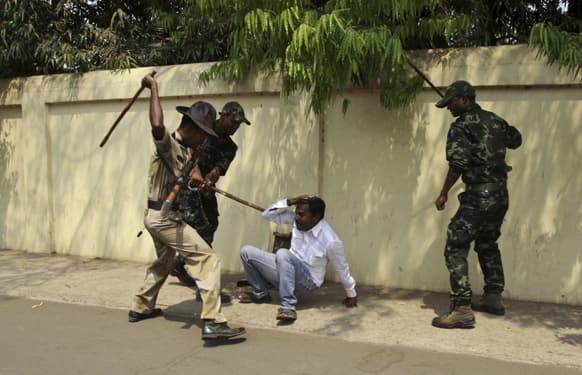 Policemen beat an opposition activist during a protest outside the Orissa state chief minister's office in Bhubaneswar.