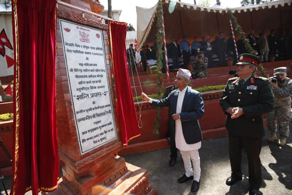 Nepal`s head of interim government Khilraj Regmi inaugurates a training for soldiers from 23 nations in Panchkhal, Kavre Palanchowk district, Nepal.