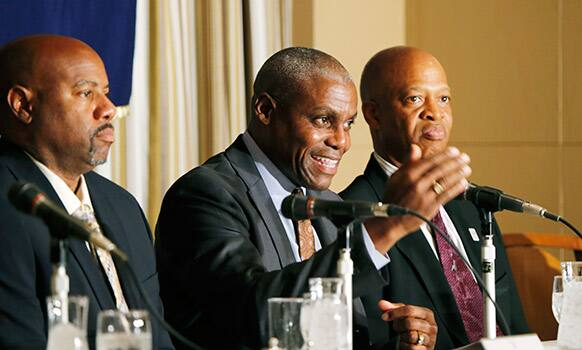 US Olympian Carl Lewis, center, speaks as fellow Olympians Mike Powell, left, and Willie Banks listen during a press conference in Tokyo.