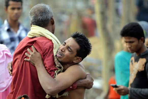 A Bangladeshi man mourns the loss of a relative who fell victim to a tornado, at Banui village, in Brahmanbaria district, Bangladesh. The tornado ripped through 20 villages in eastern Bangladesh, killing almost two dozens of people, with another 200 hurt.