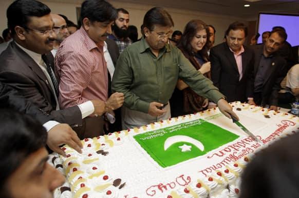 Former Pakistani President Pervez Musharraf cuts a cake during a ceremony to celebrate Pakistan National Day ahead od his trip to Karachi, in Dubai, United Arab Emirates.