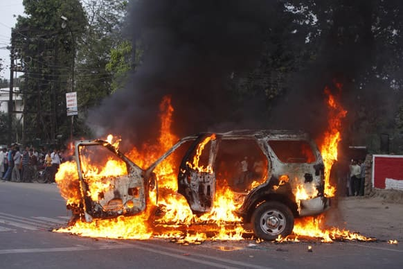 A vehicle stands in flames after it was set on fire by lawyers in Allahabad. The car had earlier hit a lawyer and others reacted to it, according to reports.