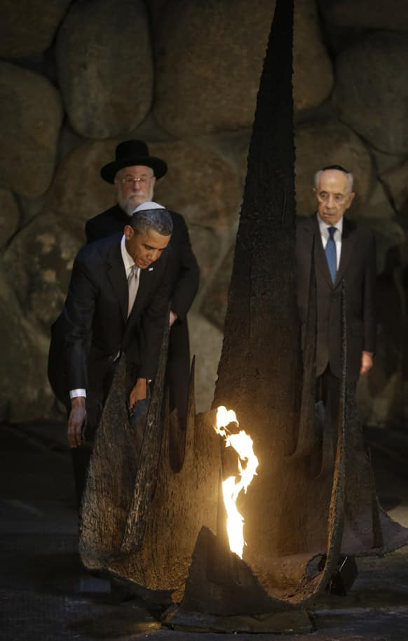 US President Barack Obama reignites the flame during his visit to the the Hall of Remembrance at the Vad Vashem Holocaust Memorial in Jerusalem, Israel.