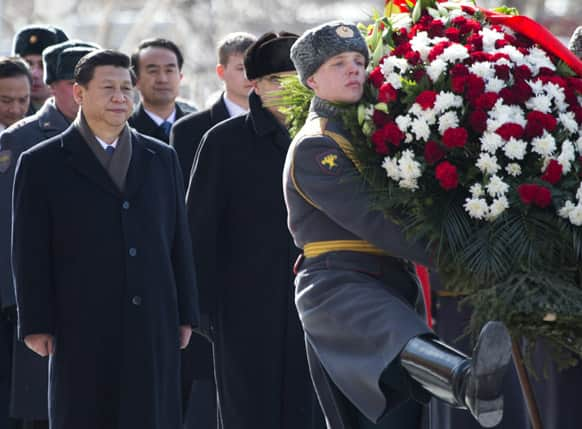 Chinese President Xi Jinping attends a wreath laying ceremony at the Tomb of Unknown Soldier in Moscow, Russia.