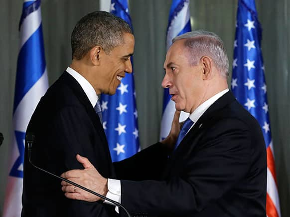 President Barack Obama and Israeli Prime Minister Benjamin Netanyahu shake hands as they participate in a joint news conference, at the prime minister`s residence in Jerusalem.