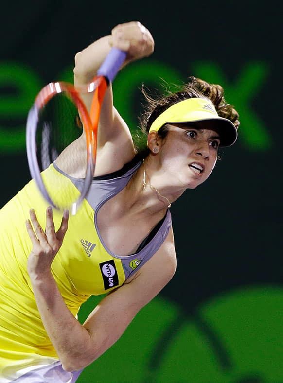 Christina McHale serves to Anett Kontaveit, of Estonia, during the Sony Open tennis tournament.