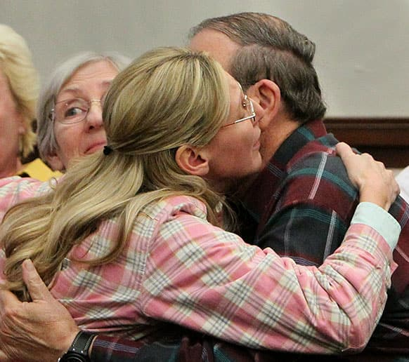 Jack Kern, right, embraces his daughter, Barbara, after the jury recommended death for Richard Beasley in the courtroom of Summit County Common Pleas Court Judge Lynne Callahan, in Akron, Ohio.