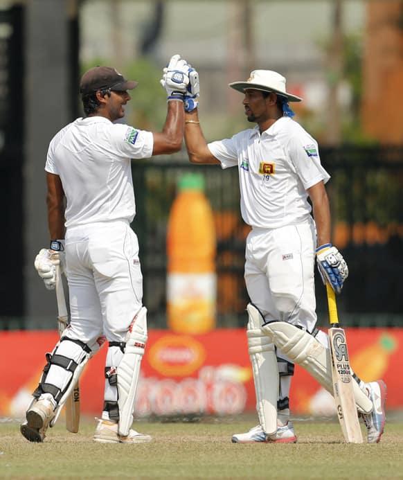 Sri Lankan batsmen Kumar Sangakkara and Tillakaratne Dilshan cheer a moment during the fourth day of the second test cricket match between Sri Lanka and Bangladesh in Colombo.