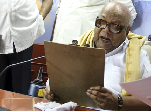Leader of the Dravida Munnetra Kazhagam party M. Karunanidhi speaks at a press conference withdrawing support to India's ruling United Progressive Alliance government, at the party office in Chennai.