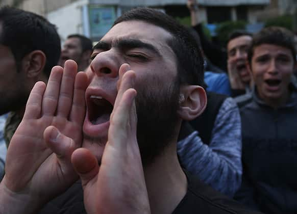 A Lebanese Sunni protester chants religious slogans, during a protest after two Sunni Muslim sheikhs at dar al-Fatwa, Lebanon`s highest Sunni Authority, were attacked by Shiite men late Sunday, in Beirut, Lebanon.