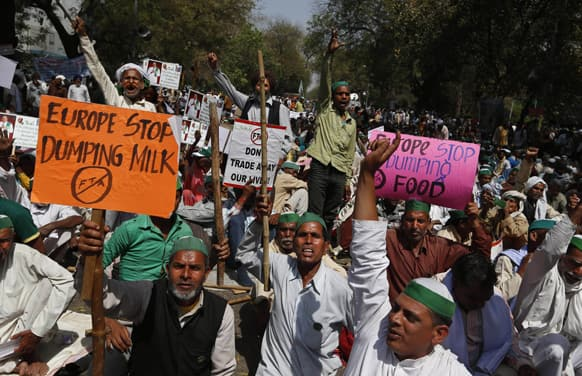 Farmers shout slogans against the government as they stage a protest near the Indian Parliament in New Delhi.
