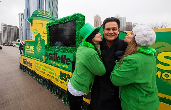 """Football Hall of Fame star Dan """"Danimal"""" Hampton declares """"Kiss Me, I'm Smooth Shaven!"""" at the Gillette float with brand ambassadors during the St. Patrick's Day Parade in Chicago."""