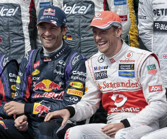 Red Bull driver Mark Webber, of Australia, and McLaren driver Jenson Button, of Britain, laugh during the official driver photo of the Australian Formula One Grand Prix at Albert Park in Melbourne, Australia.