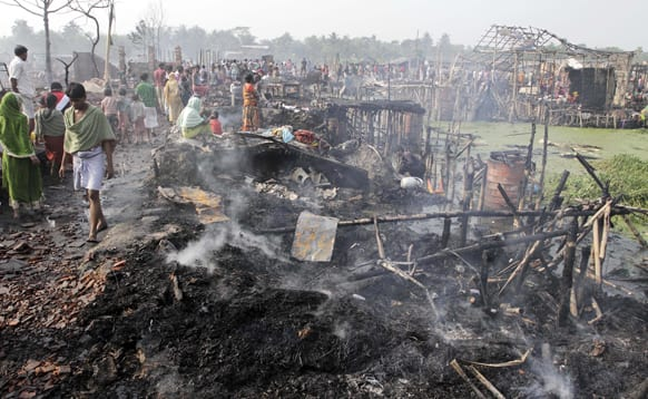 Smoke rises from the debris of shanties which caught fire early morning on the outskirts of Kolkata. More than 500 shanties were gutted in the fire. No casualties have been reported so far.