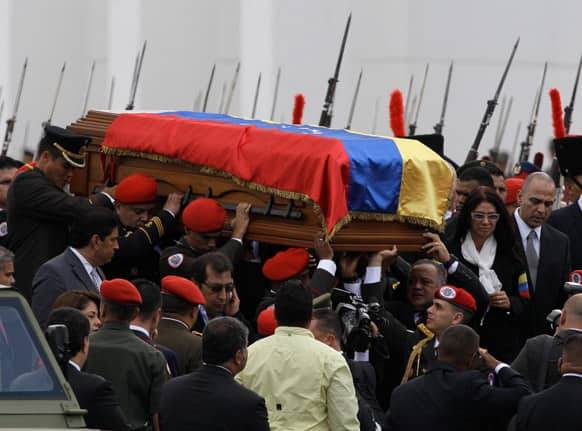 The coffin containing the remains of Venezuela`s late President Hugo Chavez is carried from the military academy, at the start of a procession to the military museum, his final resting place, in Caracas, Venezuela.