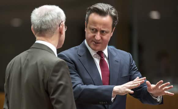British Prime Minister David Cameron speaks with European Council President Herman Van Rompuy during a round table meeting at an EU summit in Brussels.