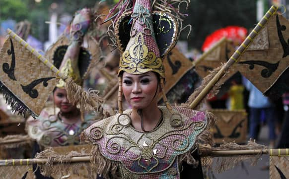 An artist performs during a cultural festival marking the end of Chinese New Year celebration in Bogor, West Java, Indonesia.