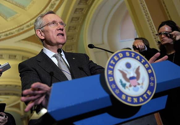 Senate Majority Leader Harry Reid of Nev. gestures as he speaks during a news conference on Capitol Hill in Washington, following a meeting with President Barack Obama and Senate Democrats.