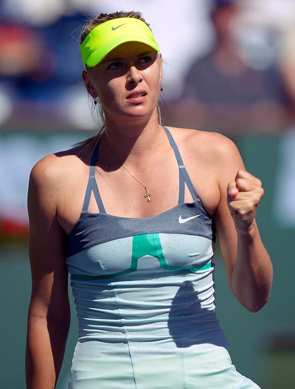 Maria Sharapova, of Russia, clenches her fist after winning a point against Lara Arruabarrena-Vecino, of Spain, during their match at the BNP Paribas Open tennis tournament, in Indian Wells, Calif.