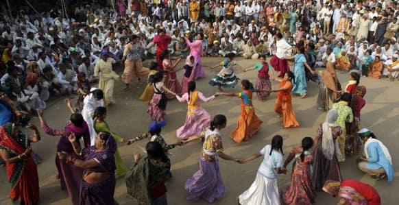 Children dance during their `Save Yamuna` river campaign march from Mathura in New Delhi.