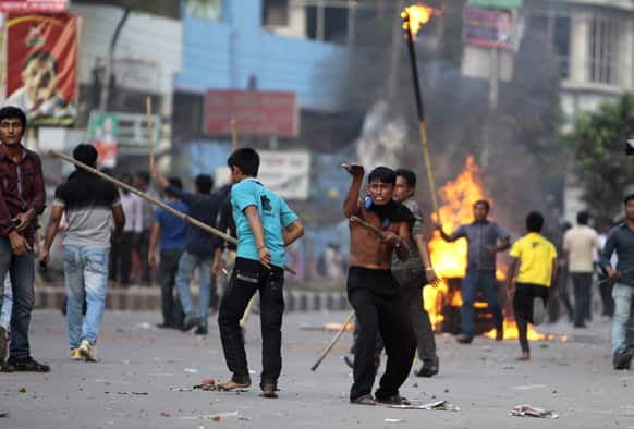 Bangladesh's opposition activists burn a street vendor`s cart as they clash with police during their protest in Dhaka.