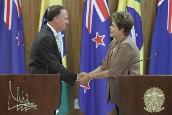 New Zealand`s Prime Minister John Key, left, shakes hands with Brazil`s President Dilma Rousseff during a joint press conference at the Planalto presidential palace in Brasilia, Brazil.