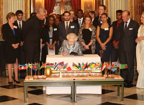 Britain`s Queen Elizabeth II, Head of the Commonwealth signs the Commonwealth Charter at a reception at Marlborough House, London.