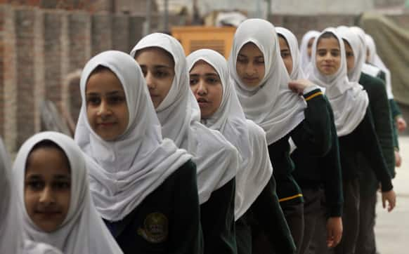 Young Kashmiri school students arrive in their school, on the outskirts of Srinagar.