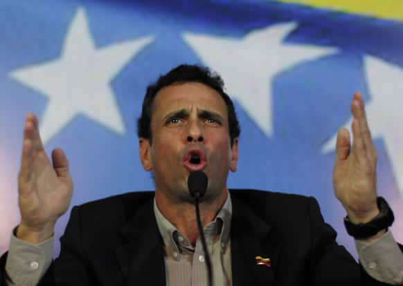 Opposition leader Henrique Capriles gestures during a press conference in Caracas, Venezuela. Capriles announced he will run in election, scheduled for April 14th, to replace late President Hugo Chavez, who died of cancer on March 5.