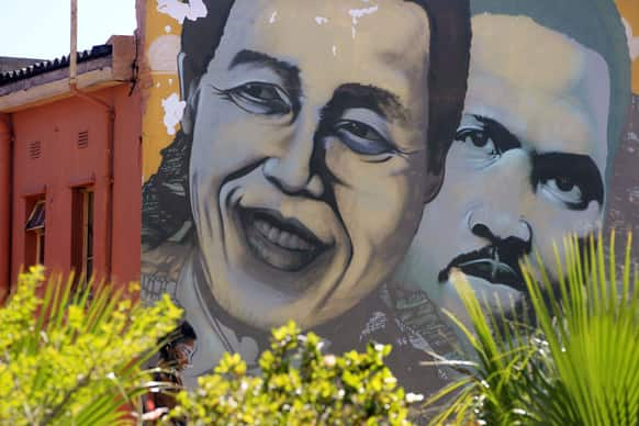 Former South African President Nelson Mandela, left, is pictured on a mural with South African apartheid freedom fighter Steve Biko, right, in the city of Cape Town, South Africa.