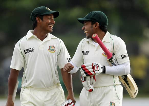 Bangladesh captain Mushfiqur Rahim, right, shares a light moment with batsman Mohammad Ashraful at the end of the third day of the first test cricket match between Sri Lanka and Bangladesh in Galle, Sri Lanka.