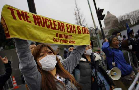 A protester holds a banner during an anti-nuclear demonstration in Tokyo.
