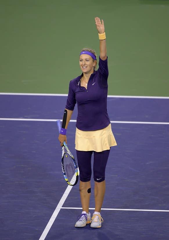 Victoria Azarenka, of Belarus, waves to fans after defeating Daniela Hantuchova, of Slovakia, at the BNP Paribas Open tennis tournament, in Indian Wells, Calif.