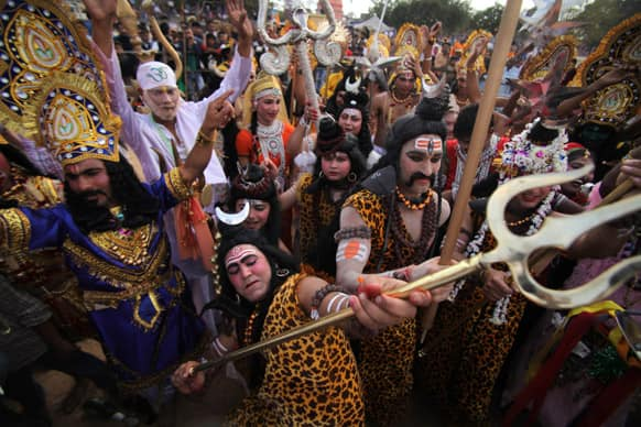 Devotees dressed as Hindu God Shiva participate in a procession on the eve of Shivratri festival in Jammu.