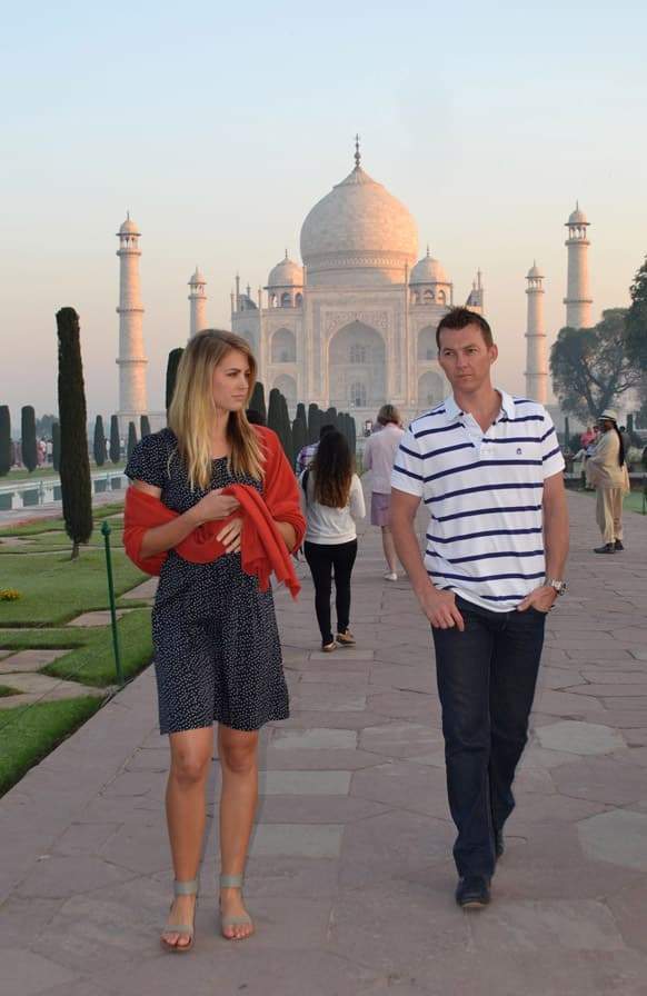 Former Australian cricketer Brett Lee and former Miss Australia Jesinta Campbell walk in front of the Taj Mahal in Agra, India. The two are in the country to shoot for a documentary.