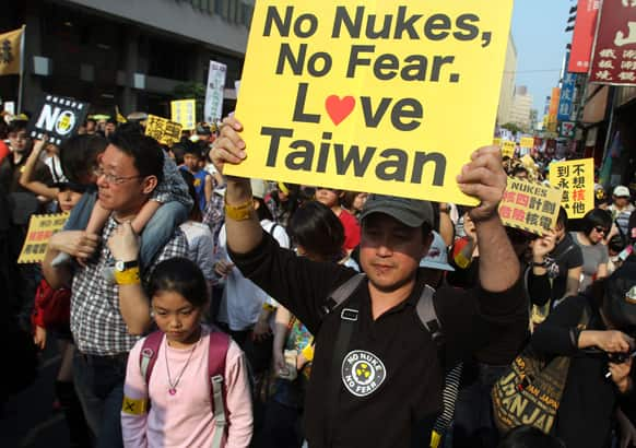 Protesters march during an anti-nuclear demonstration in Taipei. Tens of thousands of Taiwanese have protested to demand that the government scrap a $10 billion nuclear power plant that is nearly complete and slated to begin operating in two years.