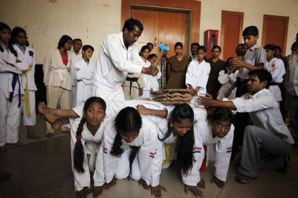 Martial arts students perform on International Women`s Day in Hyderabad.