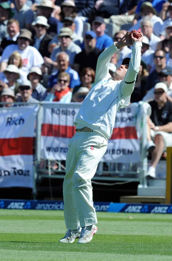 New Zealand`s Hamish Rutherford takes the catch to dismiss England`s Steven Finn for 20 off the bowling of Neil Wagner on the second day of the 1st international cricket test at University Oval in Dunedin.