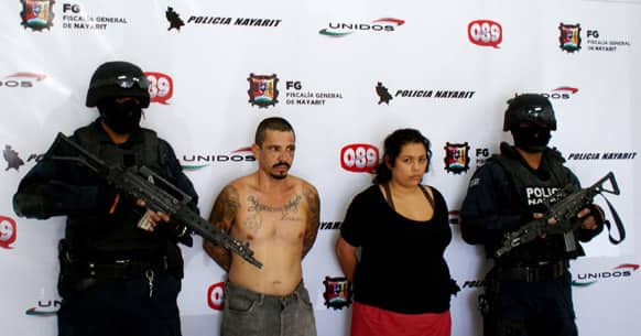 Police guard accused child rapist Eleodoro Carlos Rodriguez Sanchez and/or Carlos Roberto Tapia Sanchez, aka,