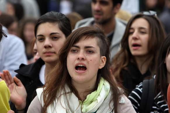 Students shout slogans during a rally against a planned shakeup of Greece`s university system in Athens.