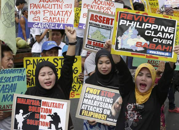 Filipino Muslims are joined by other protesters as they shout slogans during a rally near the Presidential Palace in Manila, Philippines.