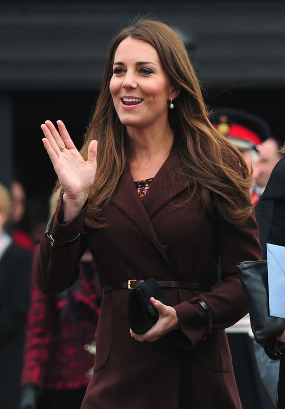 Britain`s Duchess of Cambridge Kate waves to members of the public gathered outside the National Fishing Heritage Centre, Grimsby, England.