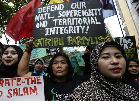 Filipino Muslims are joined by other protesters while demonstrating against the military assault launched by Malaysian forces against nearly 200 Filipino followers of Sultan Jamalul Kiram of the southern Philippine province of Sulu.