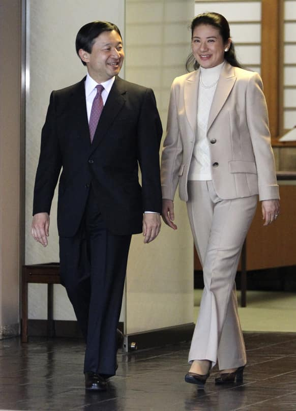 Japan`s Crown Princess Masako, right, sees Crown Prince Naruhito off as he leaves Togu Palace to depart for the United States in Tokyo.