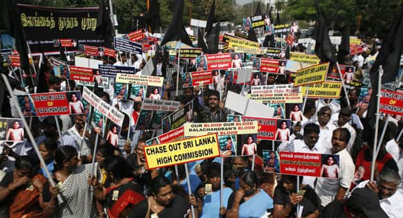Indian Tamil activists and supporters of MDMK party hold placards during a protest against Sri Lanka`s alleged wartime abuses near the Sri Lankan Deputy High Commission (SLDHC) in Chennai.