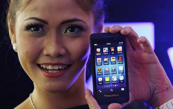 A model poses with the new Blackberry Z10 smartphone during its launch in Jakarta, Indonesia, Monday, March 4, 2013. The Z10 is priced at Indonesia Rp.6,999,000 (US$723 or EUR 555 ).