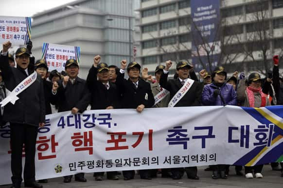 South Korean protesters shout slogans during a rally demanding the Korean Peninsula`s peaceful unification and denouncing North Korea`s nuclear test near the U.S. Embassy in Seoul.