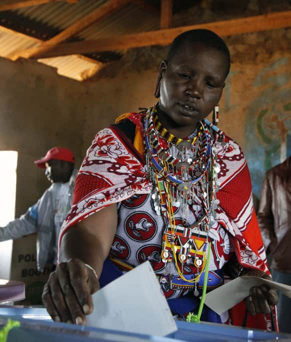 A Masai woman casts her vote in a general election in Kajiado West, some 60 kilometers (37 miles) from Nairobi, Kenya.